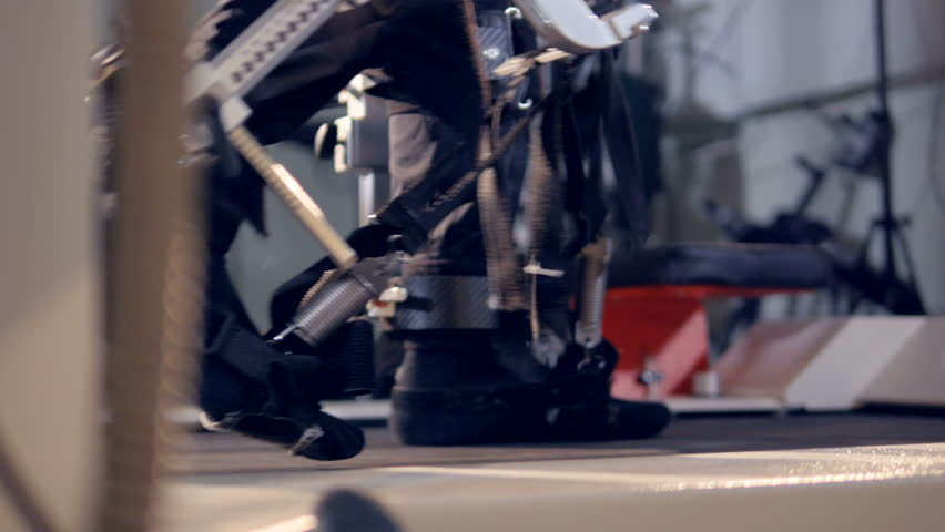 A close side view on feet during an exoskeleton training.