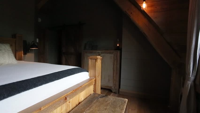 romantic bedroom in log cabin panning