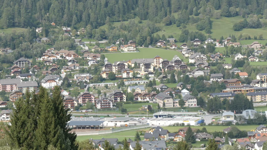 A large number of wooden houses in a ski resort, in the valley of the Austrian Alps | Shutterstock HD Video #33076387