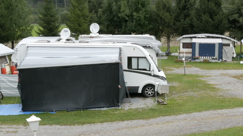 September 8, 2017 - Unterterl, Austria: Parking camping in which many trailers and in which people live. A picturesque Austrian valley on which there is a campsite