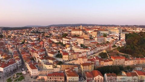 Coimbra, Portugal, aerial view of cityscape including the University of Coimbra and Clock Tower at sunset.