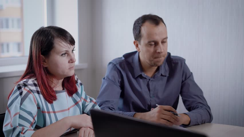 Married couple is meeting financial adviser in the office. | Shutterstock HD Video #33104107