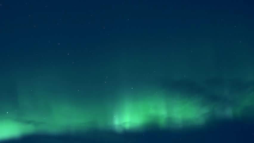 Aurora lights in cold winter, arctic green northern lights. Colour northern lights dancing in dark skies. Burning bright brilliant aurora borealis reflecting ocean breaking, Time lapse clip. Full HD. | Shutterstock HD Video #33144562