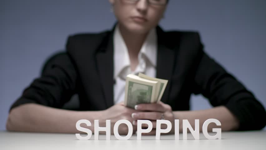 Woman counting bills bundle of money for spending by shopping. Woman shopaholic planning costs for shopping. Woman manager spending salary for shopping | Shutterstock HD Video #33170752