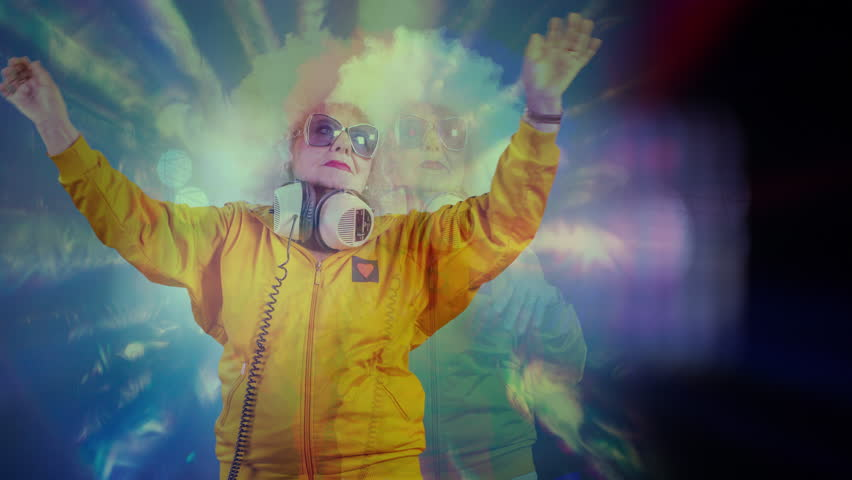 The most amazing grandma you will ever meet as a disco dancer, older lady partying in a hypnotic colourful disco setting | Shutterstock HD Video #33170812