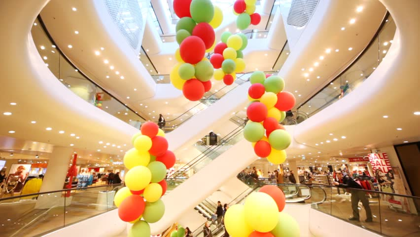 VIENNA - FEB 21: People move on escalators in Gerngross - shopping center with color balloons on Feb 21 2012 in Vienna, Austria. Gerngross is an old department store in Vienna.