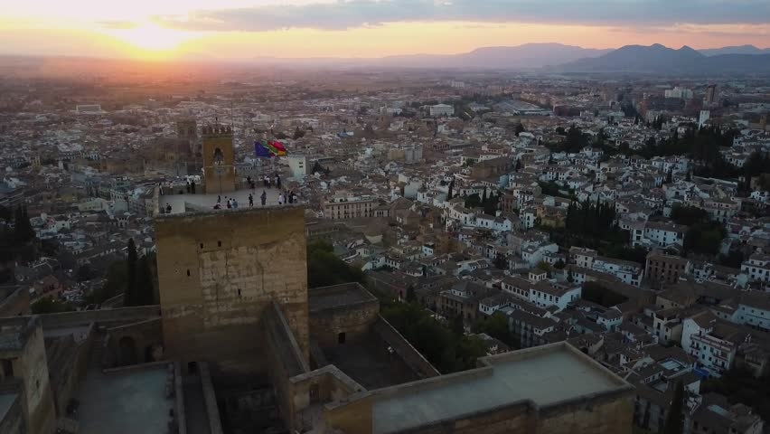 4k aerial drone footage - Tourists atop the medieval castle, The Alhambra, at sunset.  Granada, Spain.  This ancient fortress was built by the Moorish Caliphate.