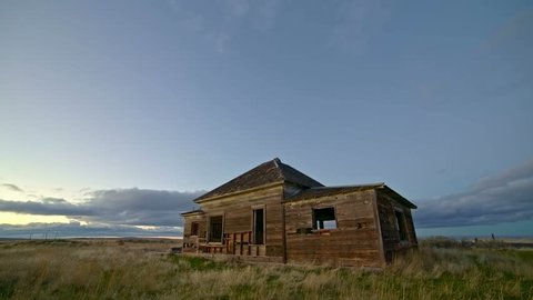 Old abandoned house farmhouse pioneers great depression settlers at sunset