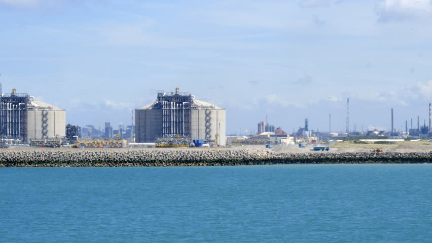 LNG storage tanks in Liquefied Natural Gas Terminal, with an oil refinery in background,  Dunkerque, France