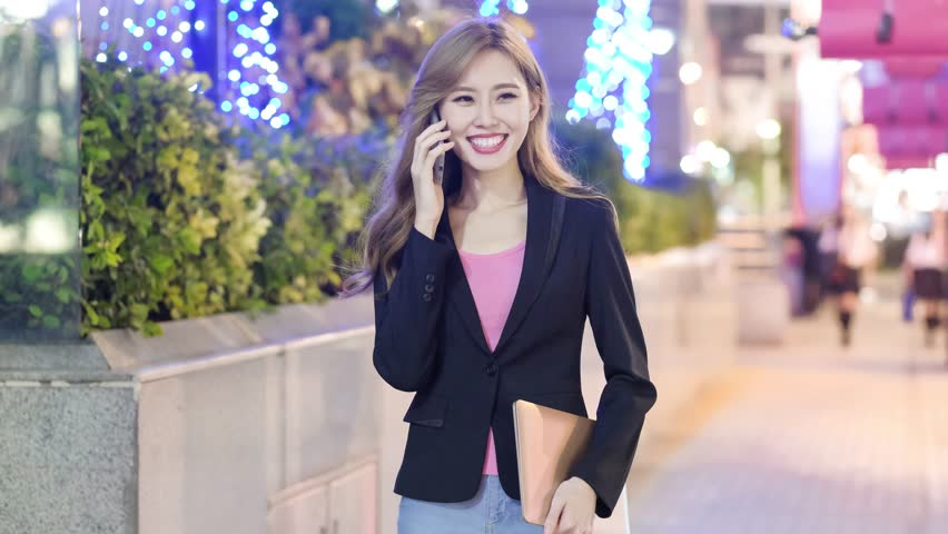 Business woman smile and speak phone in the evening | Shutterstock HD Video #33233782