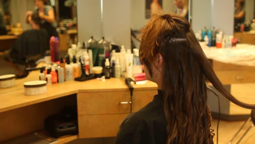 Woman having hair styled at hair salon
