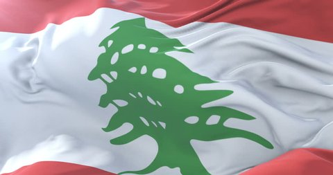 Flag of Lebanon waving at wind with blue sky in slow, loop