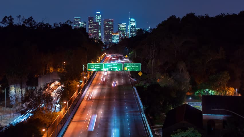 Time-lapse of the 110 expressway headed toward Downtown Los Angeles at night | Shutterstock HD Video #33300721