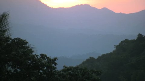 Vivid sunset over high mountains in the Republic of the Philippines