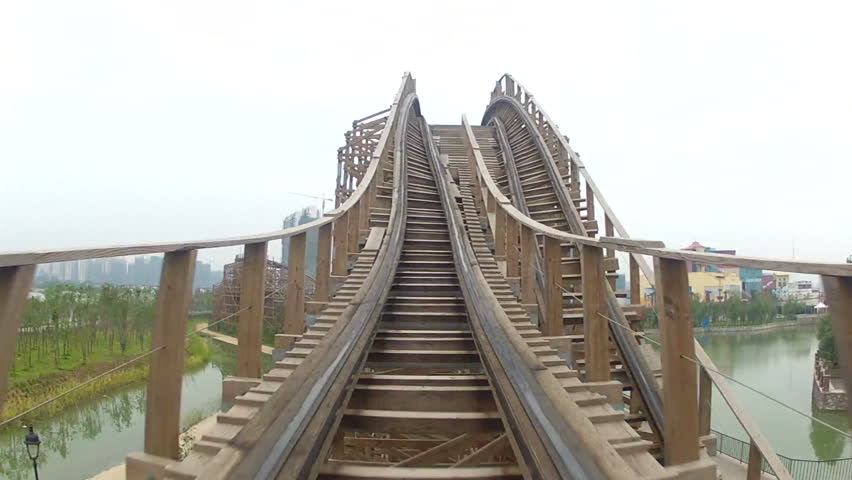 Flying through turns on wooden roller coaster
