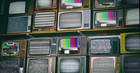 Wall of old wooden TV screens with test signal and black and white static noise caused by bad signal reception