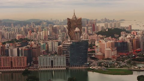 Macau Skyline at daytime with Lisboa Grand and Roundabout and Casinos – medium wide shot