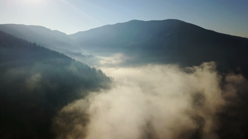 Aerial view of the mountains with a morning fog | Shutterstock HD Video #33383692