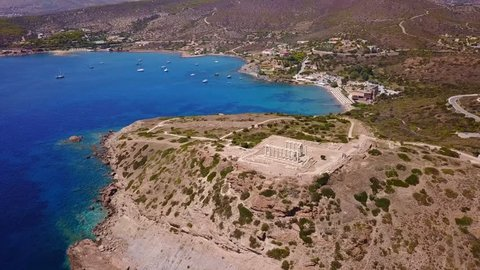 Aerial drone bird's eye video taken by drone of archaeological site of Cape Sounio, Temple of Poseidon, Attica, Greece