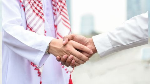 Parallax video Arabic and businessman shaking hand for success corporation concept on cityscape background by beautiful moment movement