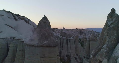 Aerial view of rocks in Goreme National Park. Extraordinary formation in Cappadocia top view. Flying above famous destination in Turkey.