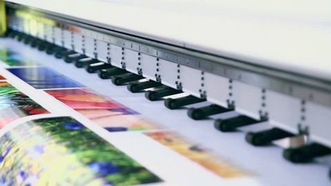 Printing head creates colorful image on paper in machine