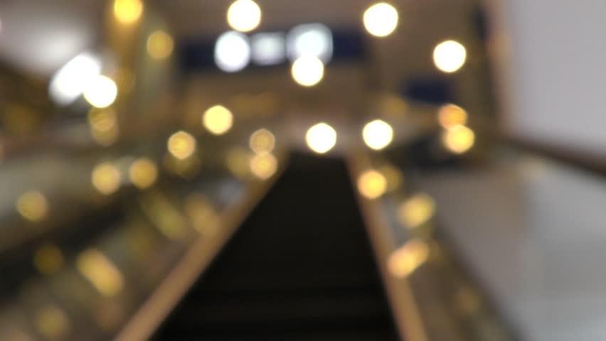Blur background shopping mall - customers using escalators | Shutterstock HD Video #33464482
