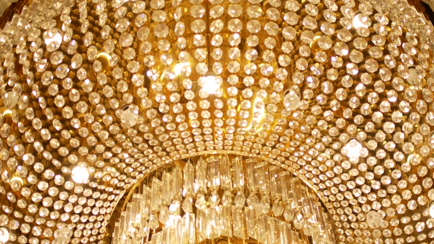 A very expensive chandelier in a chic restaurant or concert hall. Concept of luxury life. The video is suitable for the background