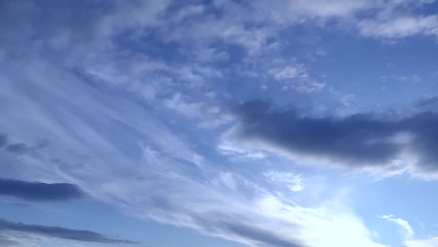 White rolling clouds time lapse, fluffy cloud, blue skies. Beautiful white clouds soar across the screen in time lapse fashion over a deep blue background. White puffy clouds move across a brilliant.