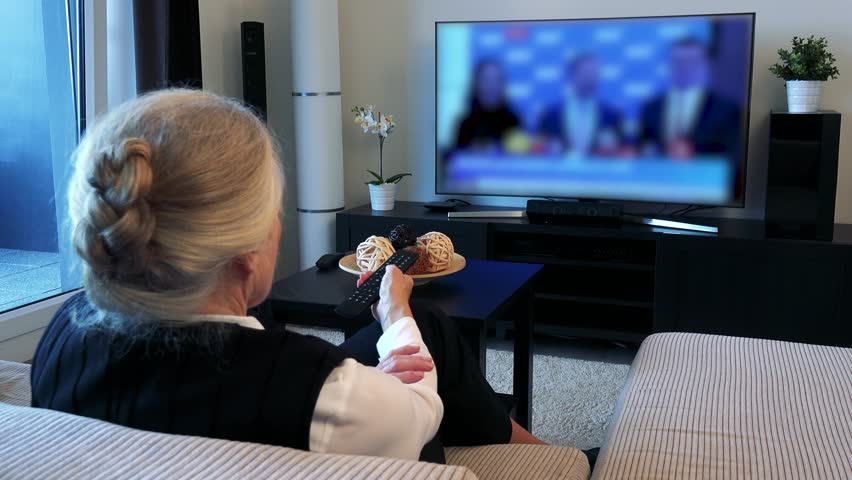 Old Caucasian Woman Watches Television In Living Room - Archival ...