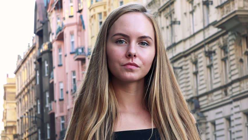 Young beautiful woman shows thumb up to camera in the city | Shutterstock HD Video #33522022