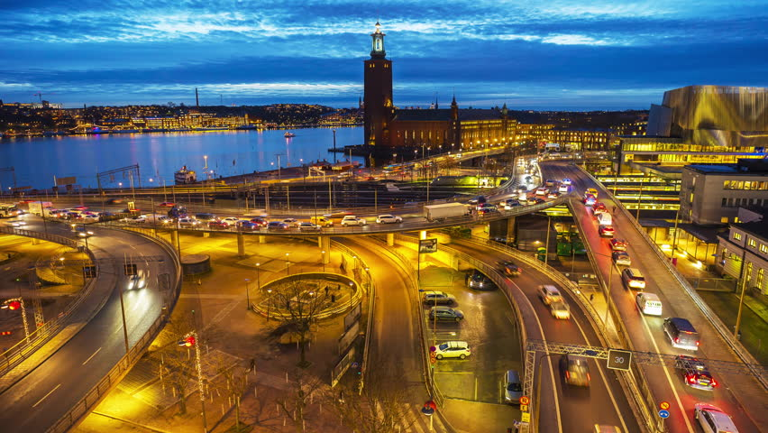 Time lapse of intense traffic in central Stockholm. In the backdrop, the famous City Hall