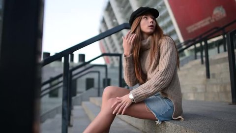 Beautifull skinny model posing in the city sunlights