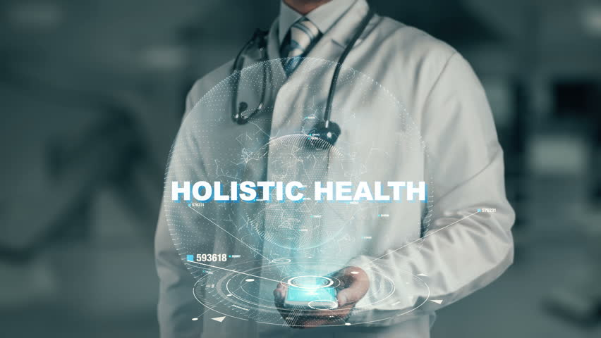 Doctor holding in hand Holistic Health | Shutterstock HD Video #33584587