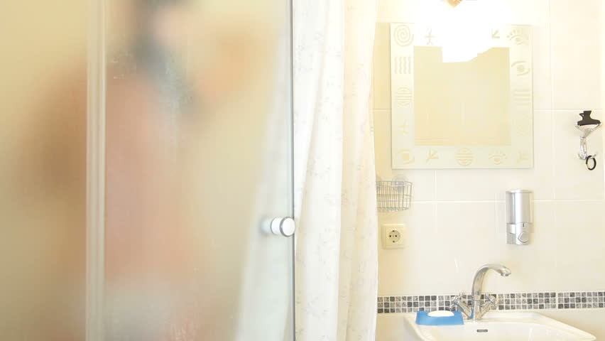 Blurred Female Body in Bathroom