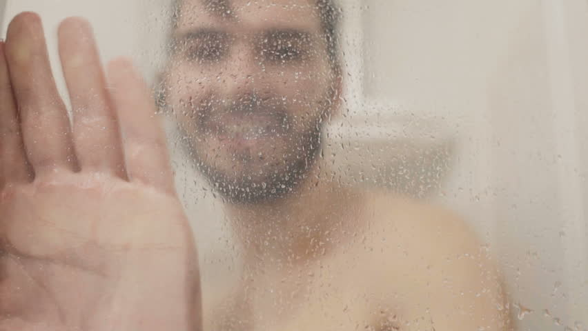 Cheerful man has fun with shower inside the shower cabin | Shutterstock HD Video #33627802