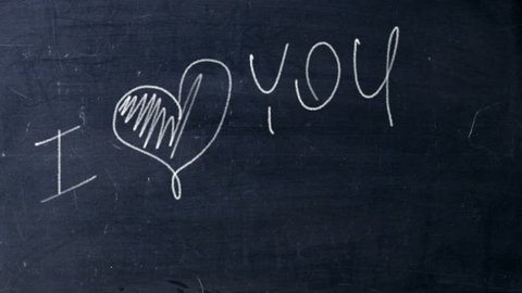 I love you. Handwritten chalk on a black chalkboard. Arrow shot heart shape. Love at school concept.