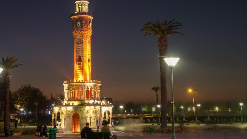 People near clock tower of Izmir at evening timelapse, Turkey