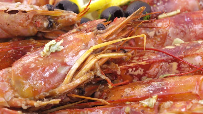 On a dish with hieroglyphs Norwegian lobster or langoustine or scampi in brown rice