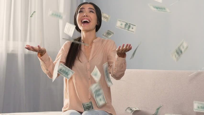 Money falling on happy shopaholic woman enjoying cash back service, slow motion   Shutterstock HD Video #33677392