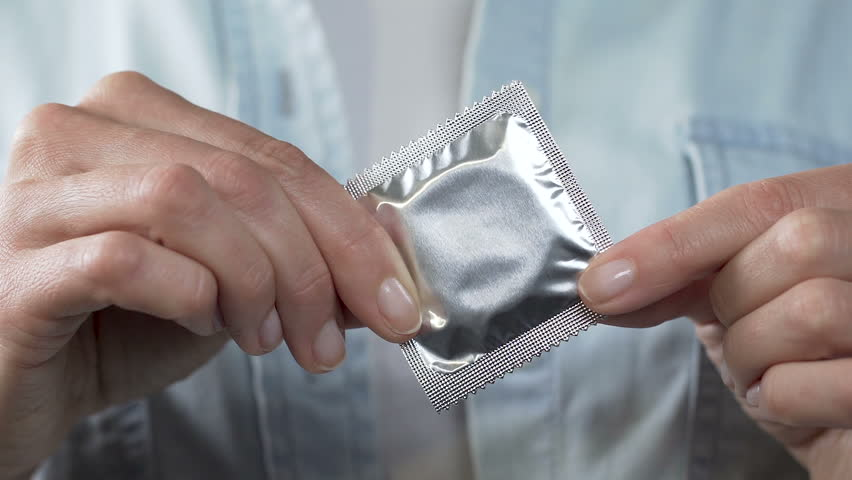 Female Fingers Holding Sealed Condom, Stock Footage Video -1658