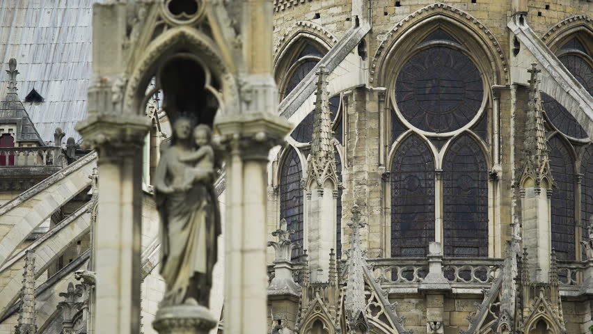 Facade of Notre-Dame de Paris cathedral, statue of Our Lady, gothic architecture | Shutterstock HD Video #33682372