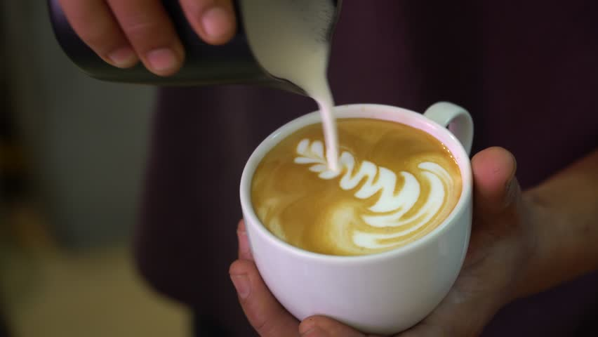 Close up barista hand making art coffee in coffee bar. | Shutterstock HD Video #33712282