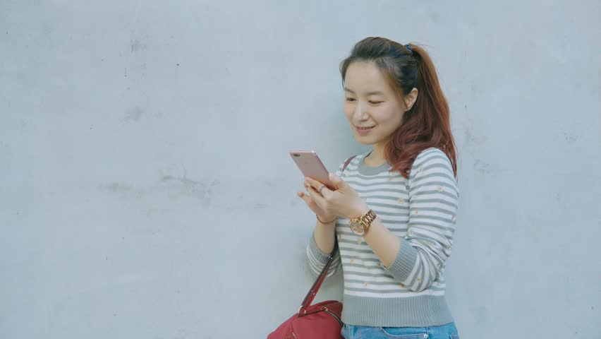 Woman smile and use phone in the evening | Shutterstock HD Video #33716662
