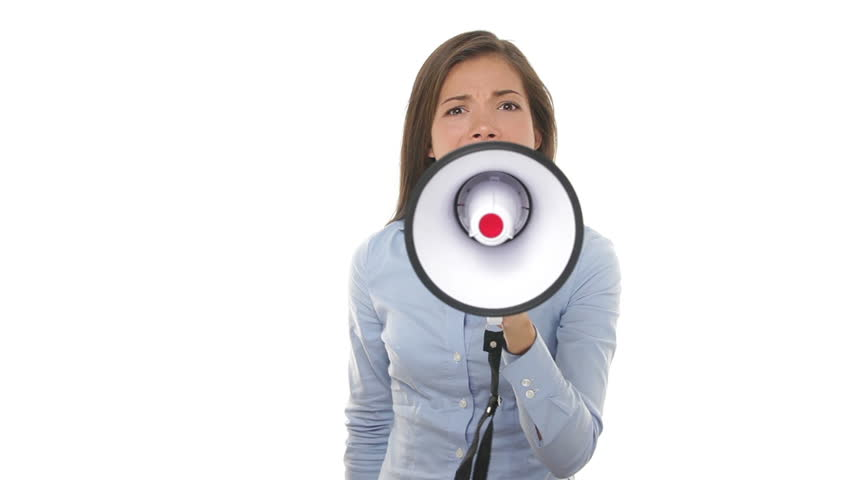 Business woman screaming angry in megaphone looking at camera yelling upset and unhappy. Young mixed race Asian Chinese / Caucasian female businesswoman on pure white background.