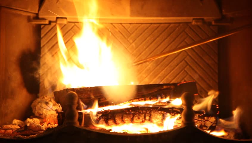 Round Logs Burn In Fireplace Ancient Br Fire Iron Corrects Burning Coals Man Hand Puts Next Log Into Hd Video