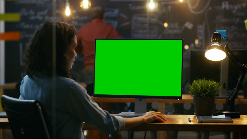Beautiful Female Office Employee at Her Desktop Works on a Mock-up Green Screen Personal Computer. Over the Shoulder Footage.  Shot on RED EPIC-W 8K Helium Cinema Camera. | Shutterstock HD Video #33748672