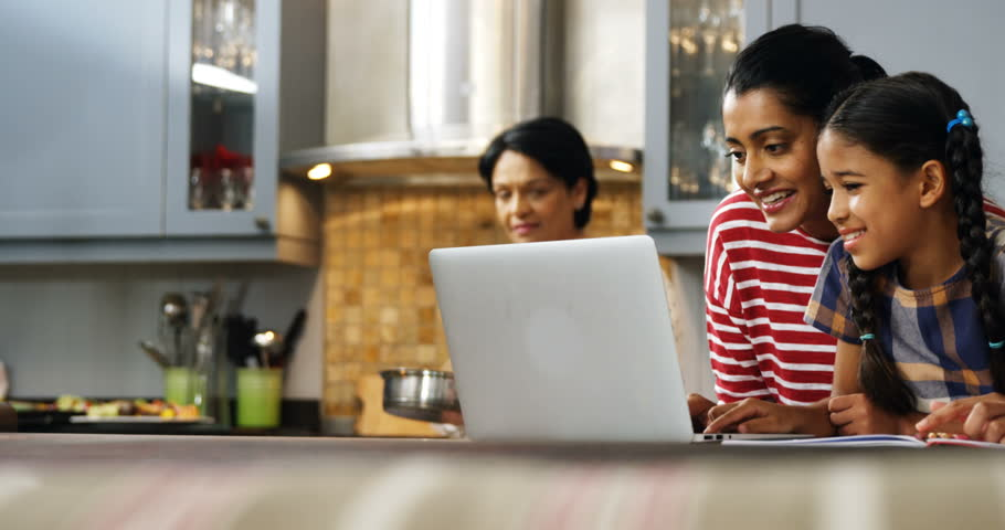 Multi-generation family using laptop in kitchen at home 4k | Shutterstock HD Video #33751963