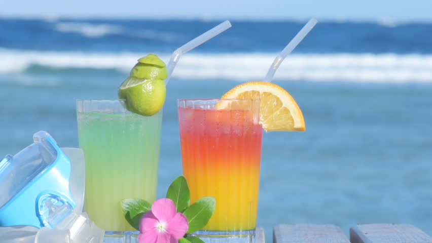 Cocktail In A Glass With A Tubule Against Blue Water Sex On The Beach Stock Footage -6444