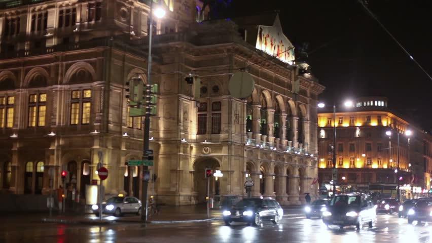 movement of cars at night near the Vienna State opera
